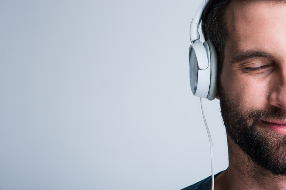Man with headphones on a grey background