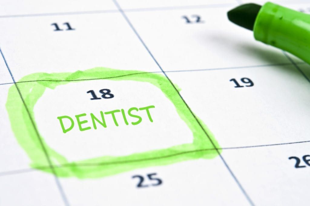 """calendar with a day highlighted and labeled """"dentist"""""""